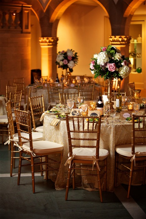 bold-elegant-uplighting-and-floral-pedestal-centerpieces-with-linens